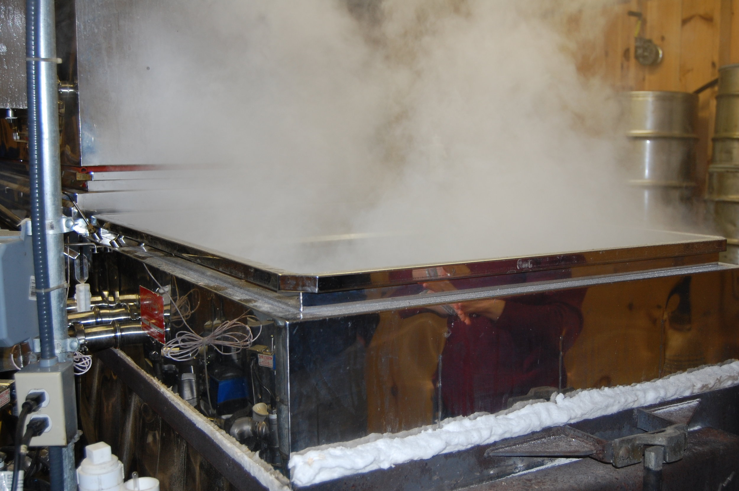 Sweet steam rising from the evaporator in the sugar house