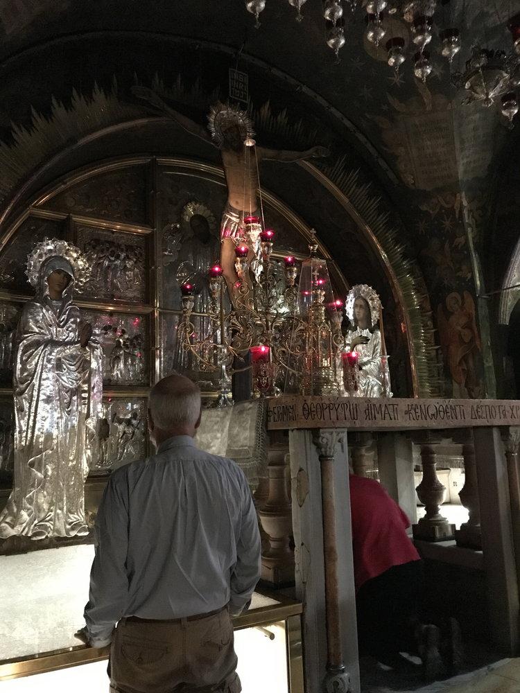 Pilgrims venerating Calvary, the very spot where the Cross stood.