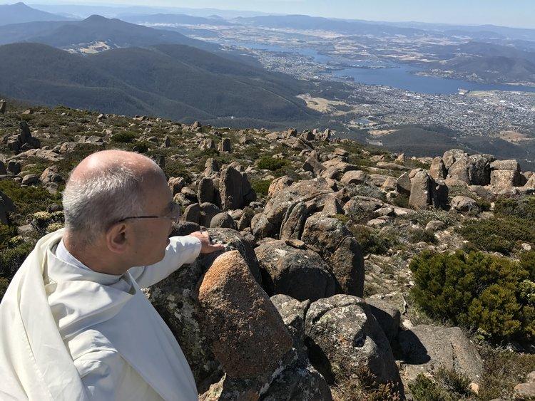 Fr John enjoying the view from Mount Wellington
