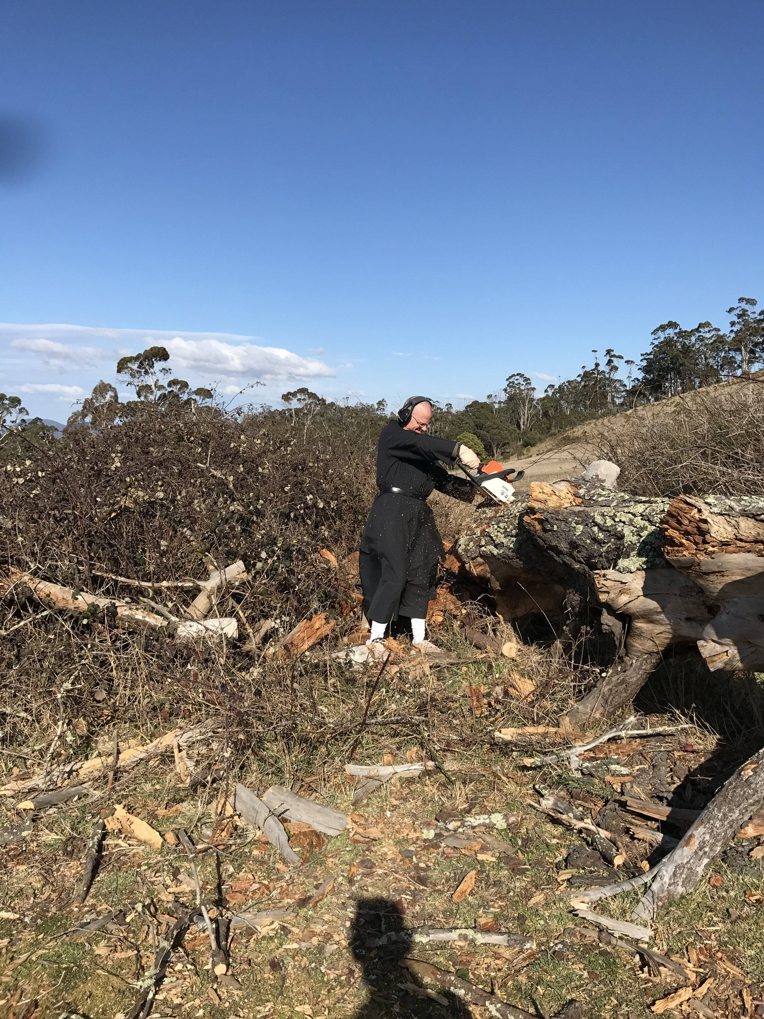 Father Prior having a great time with the chainsaw...