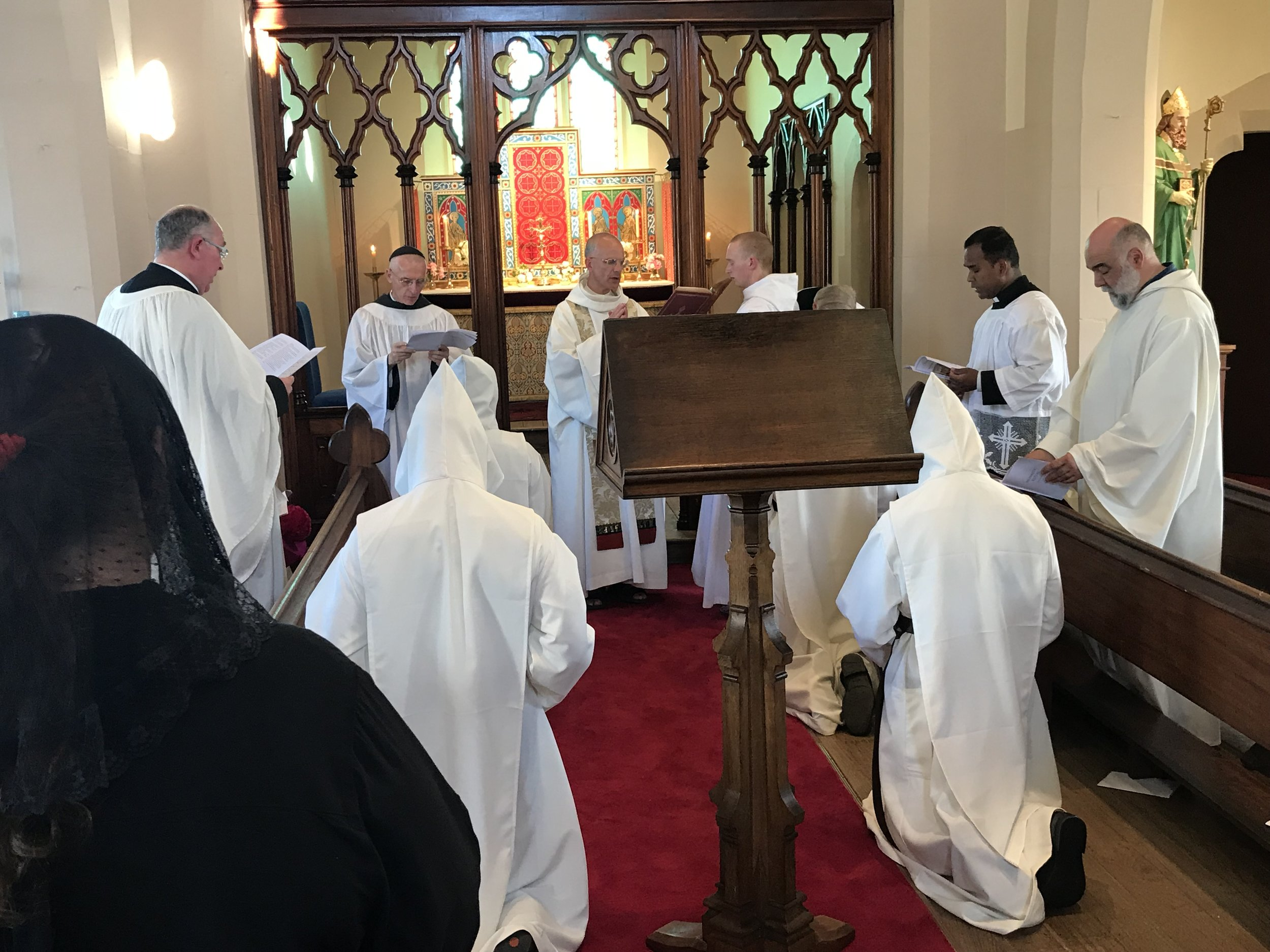 Father Prior chants an oration over the newly clothed novices.
