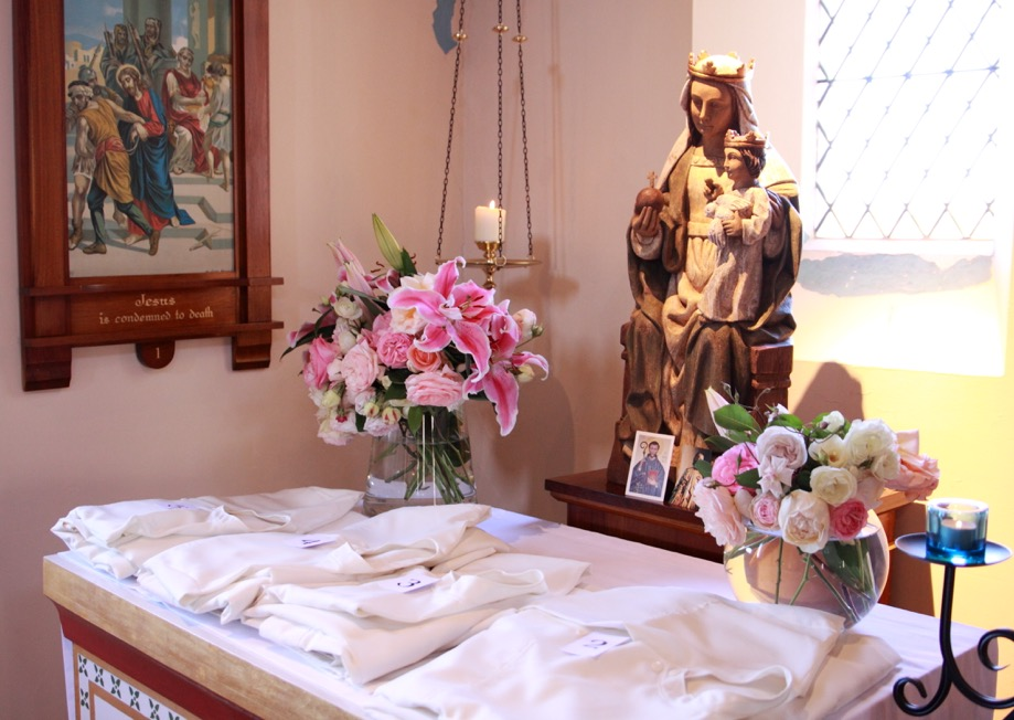 The white habits laid before Our Lady before the ceremony.