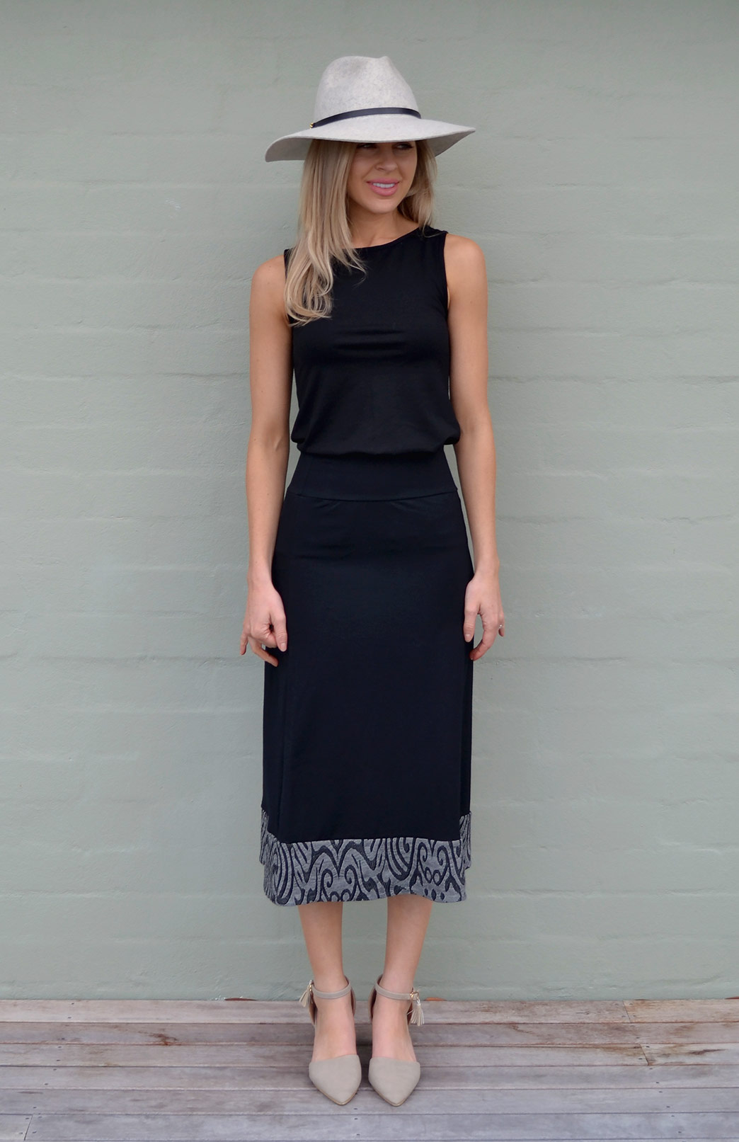 Chic and elegant with that little peek of pattern down the bottom- also available in blue