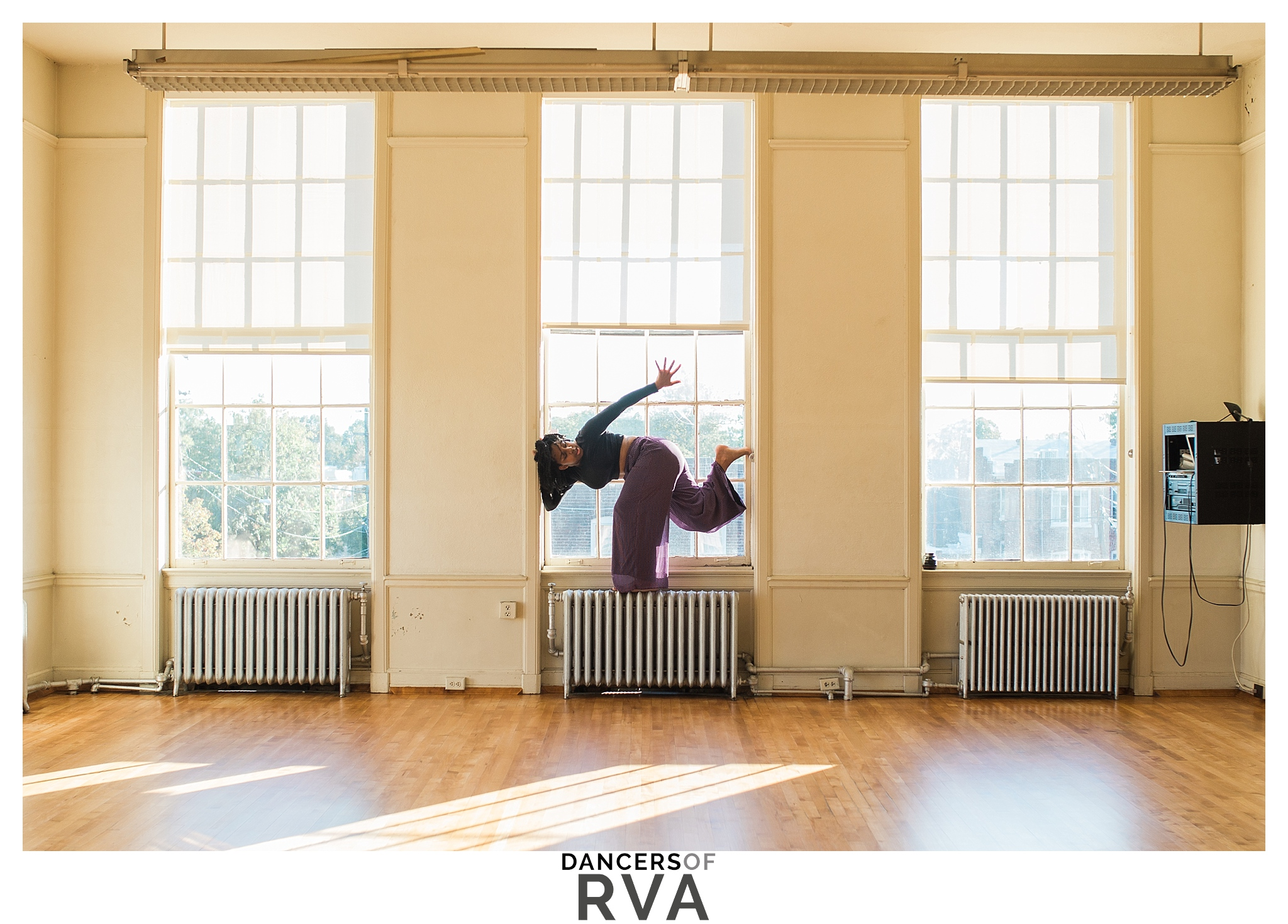 modern dancer in window frame at VCU dance