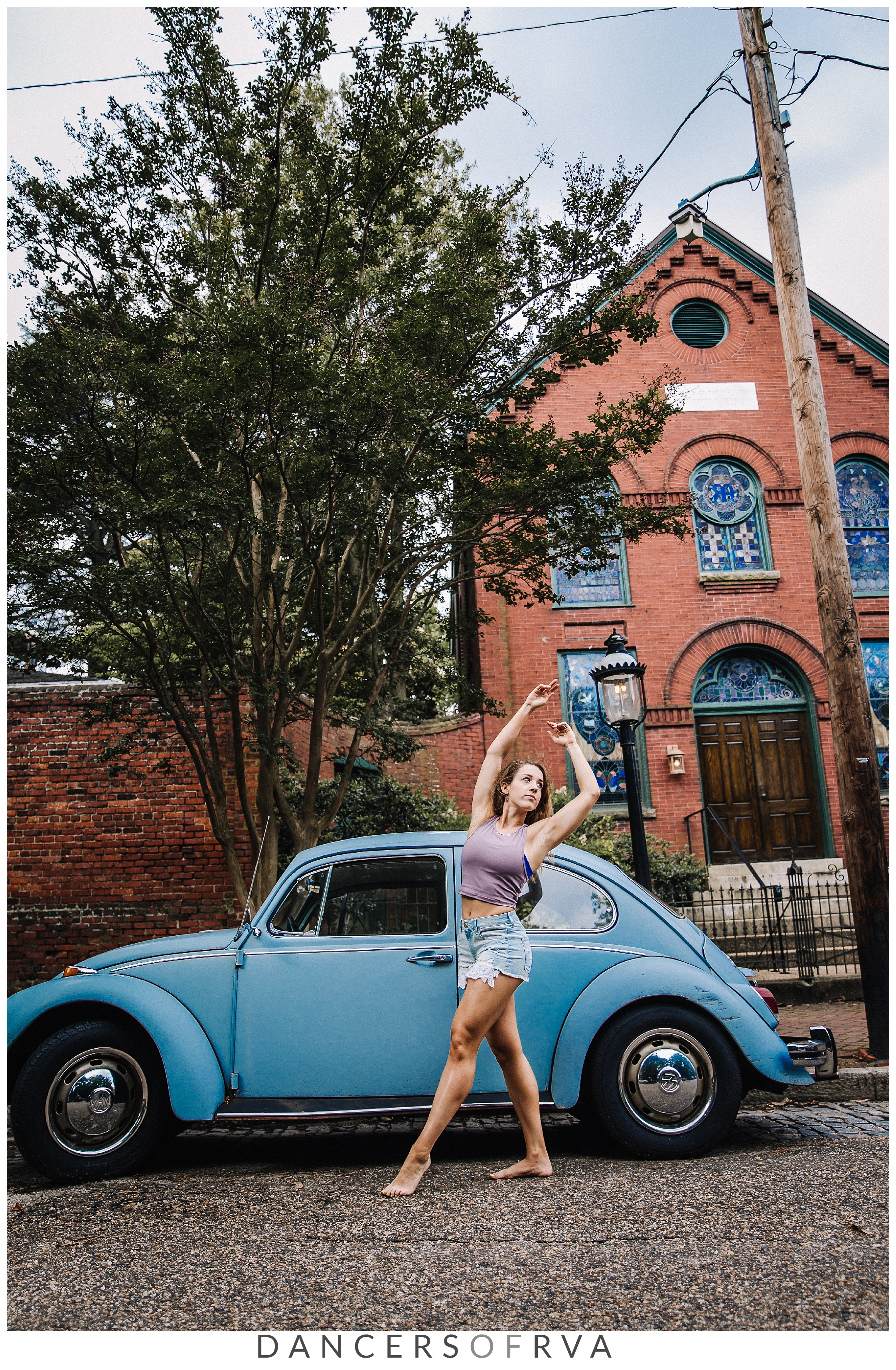 Dancers of RVA _ Karar Dance Company in front of a vintage blue VW beetle