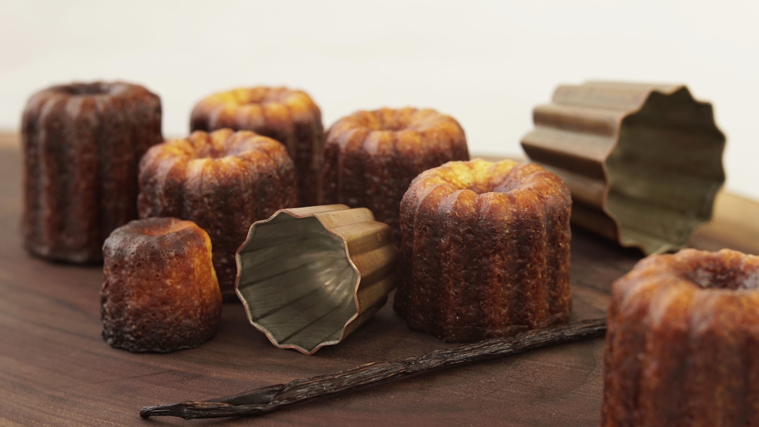 A picture of the Canele (also spelt Cannele) from Bordeaux, made by Saveur Sucrée bakery in Toronto