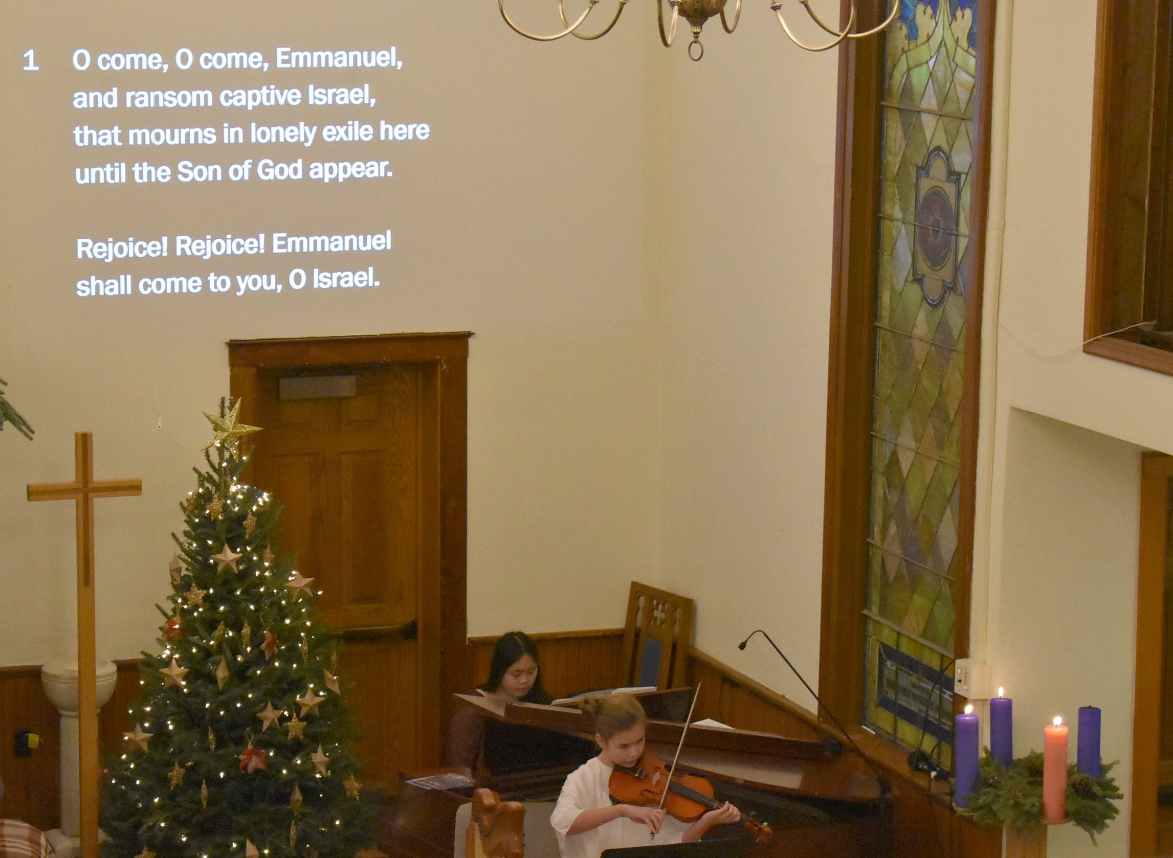 Piano accompanist to the Almost Angels children's choir.