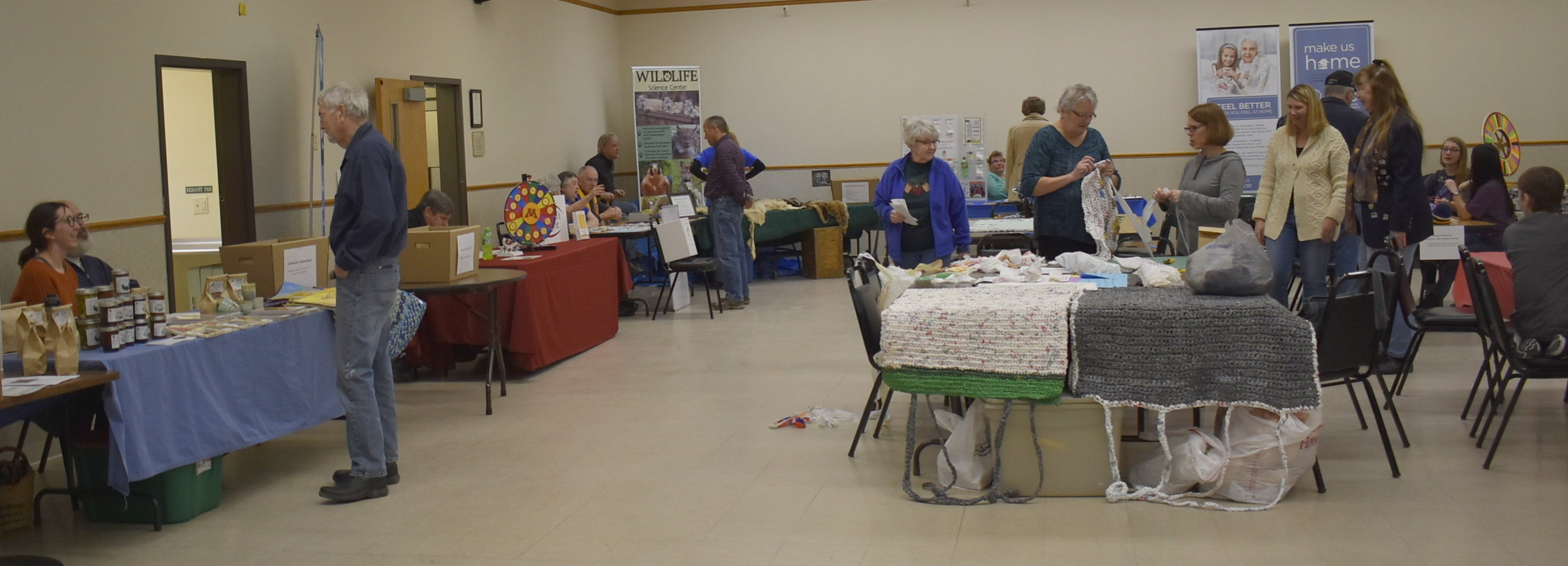 A variety of non-profits were at the One Stop Donation Drop including those pictured here: Community Homestead, Lions Gift of Sight, Scandia-Marine Lions Club, Wildlife Science Center, Minnesota Lions Diabetes Foundation, Christ Lutheran Church, and Osceola Medical Center. People could learn how to make plarn (plastic yarn) from plastic bags and use that to help crochet mats for those experiencing homelessness. The table behind the mats had fleece-tied blankets that were made for children and teens experiencing life-threatening health issues. There were additional organizations and activities at the event that aren't pictured here.