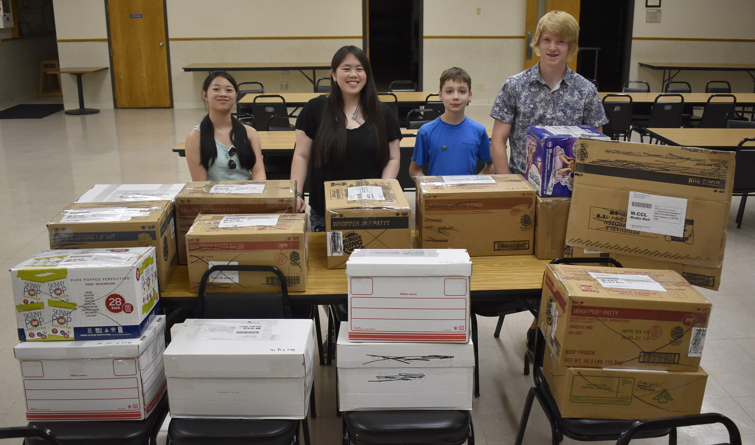 Give Life...Give Hope partnered with the Forest Lake-Scandia Leo Club to package the 1,012 books and learning materials for the library in Malawi, Africa.