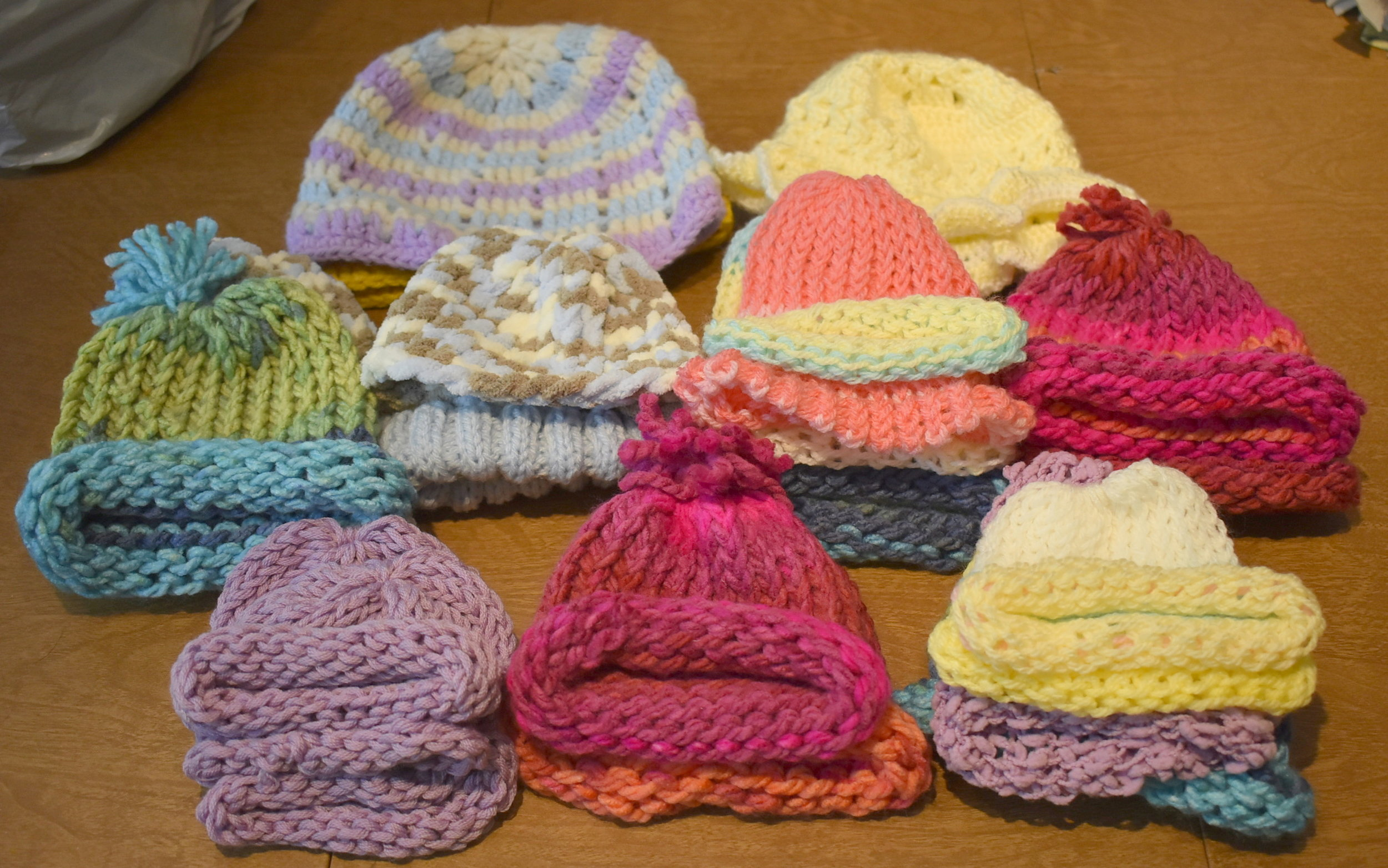 13 knit hats for newborns at Fairview Hospital in Wyoming (MN) and 10 knit hats for pediatric cancer patients at Children's Hospital in Minneapolis.