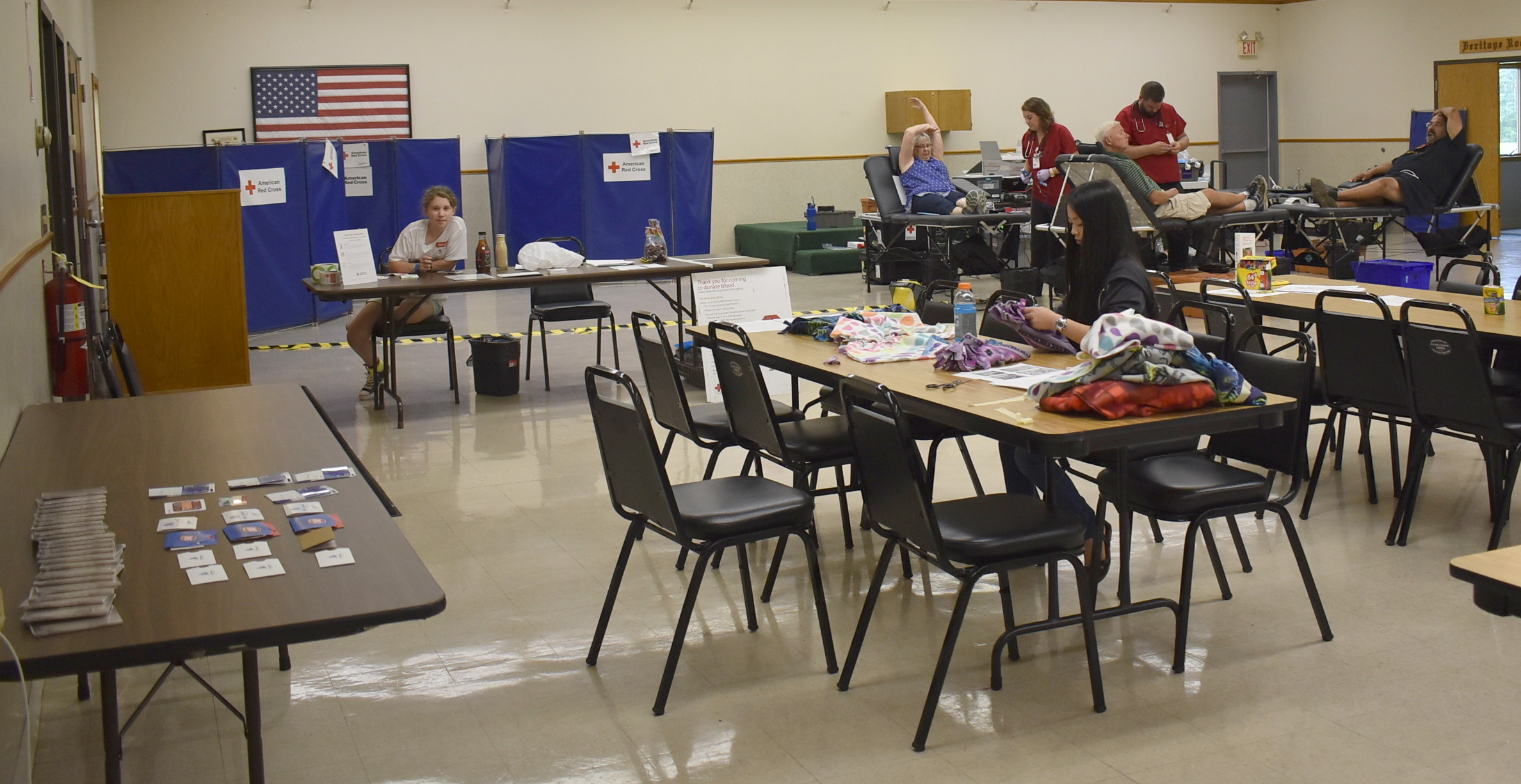 Three blood donors were donating blood (for a total of 26 donors), no-sew fleece-tied hats were made for children with cancer undergoing chemotherapy, and sheets were colored for Color-a-Smile at the Scandia Community Center on July 11, 2018.