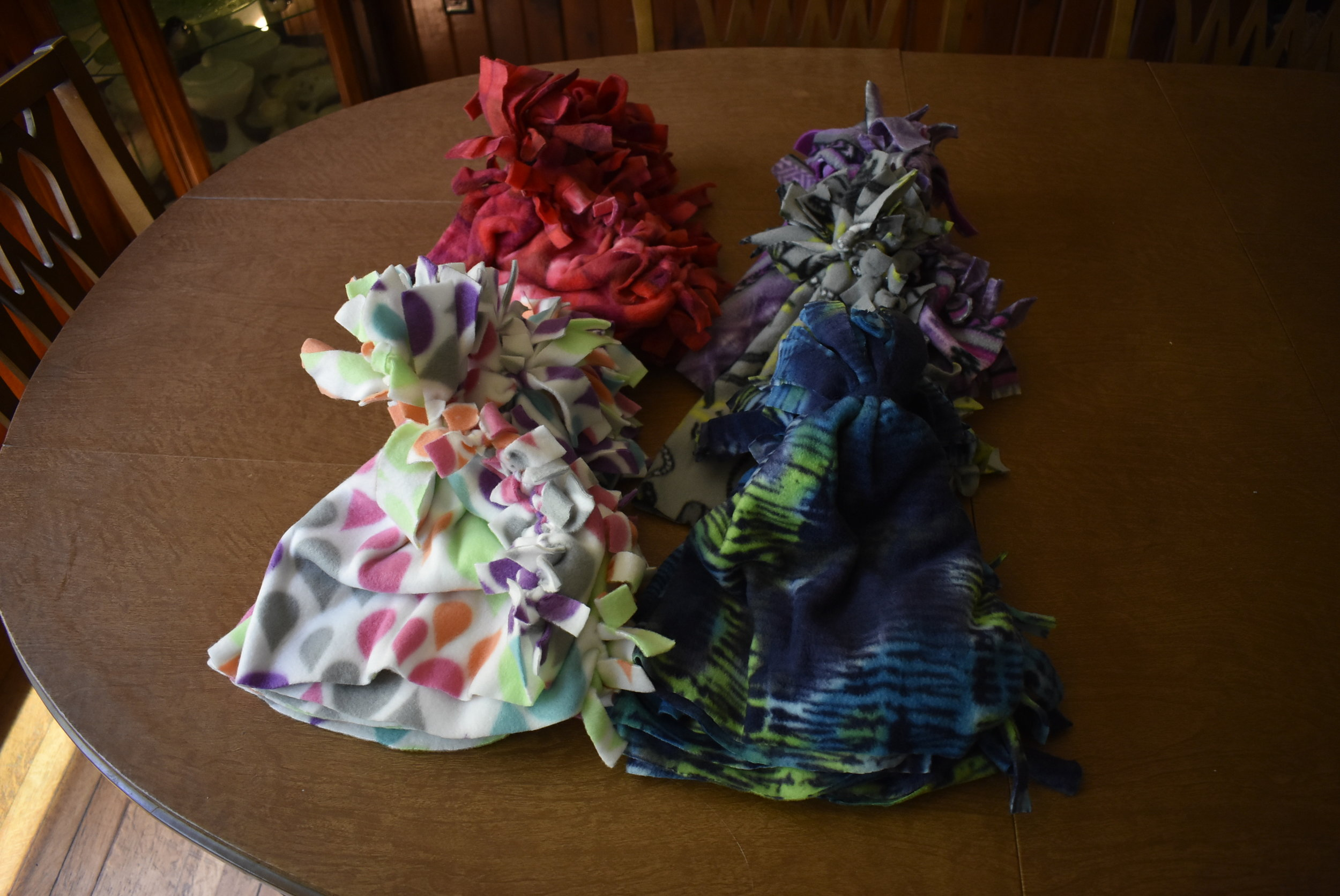 No-sew fleece-tied hats that were made at the Scandia Farmers Market on July 11, 2018. These will be donated to Children's Hospital in Minneapolis for children who have cancer and are undergoing chemotherapy.