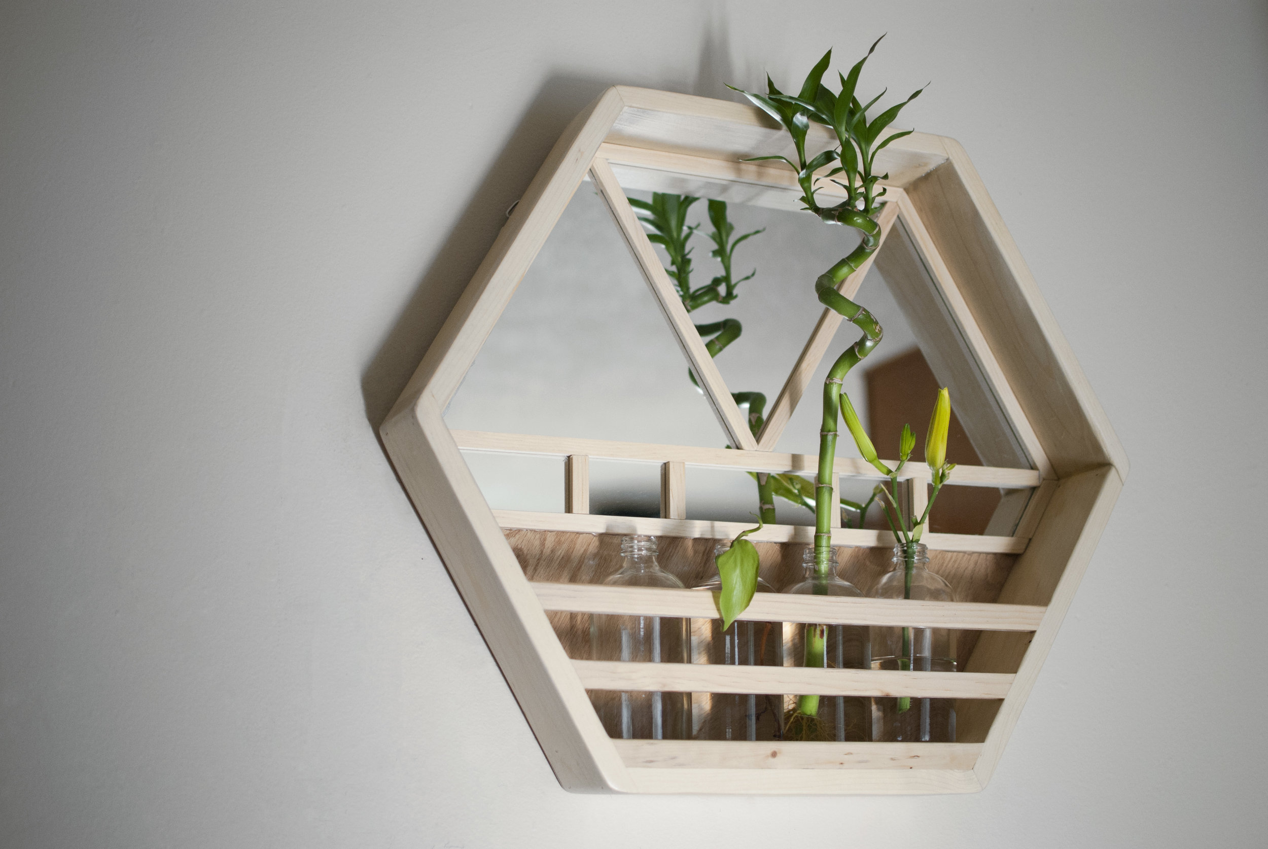 Chuck made this hexagonal wall planter from reclaimed wood and mirrors.  The jars currently house bamboo and freshly cut daylilies. It's so fun to wait for those flowers to open up!