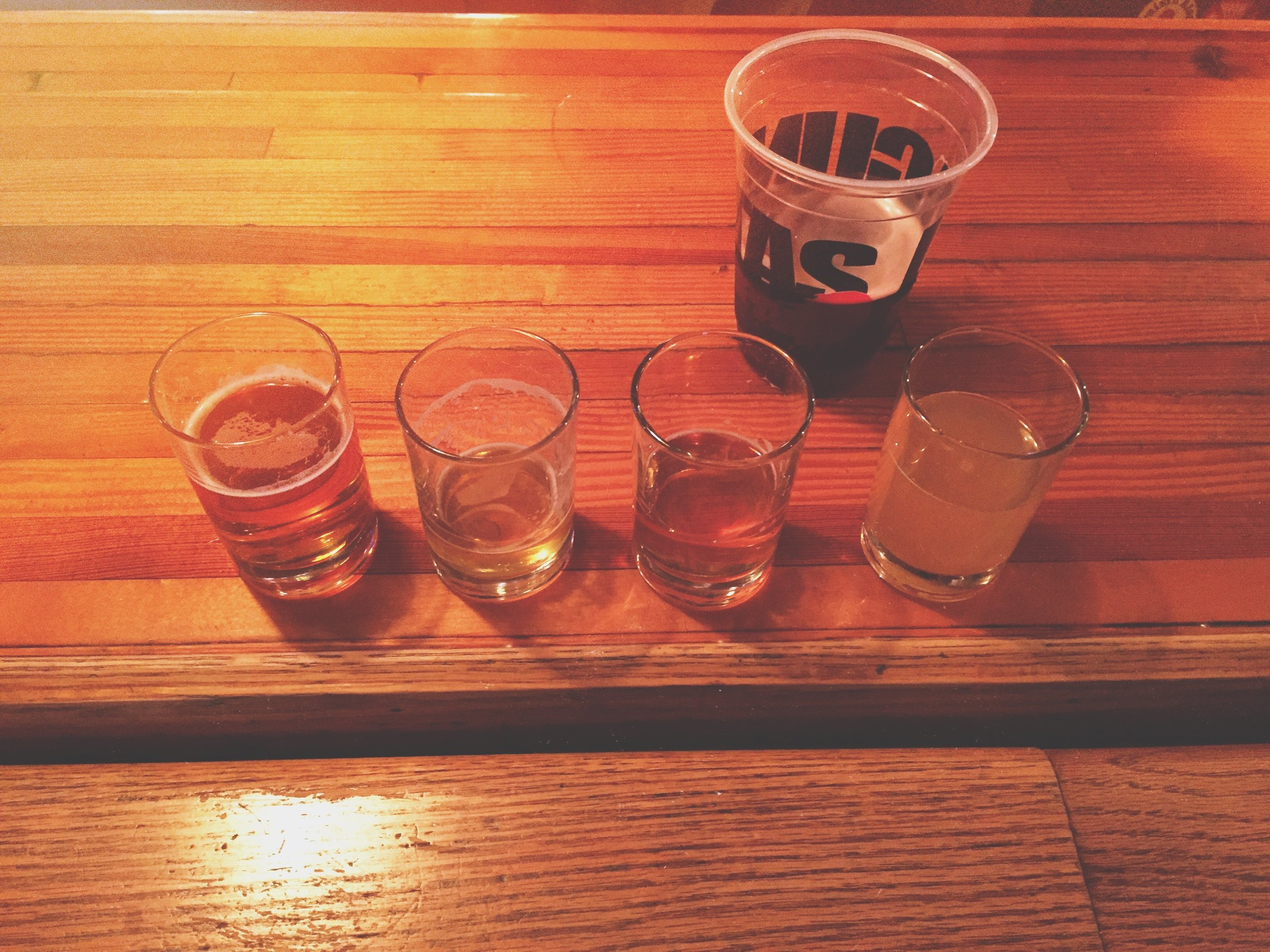 "Lagunitas Beer Tasting. ""Whey Far Out"" on the right."