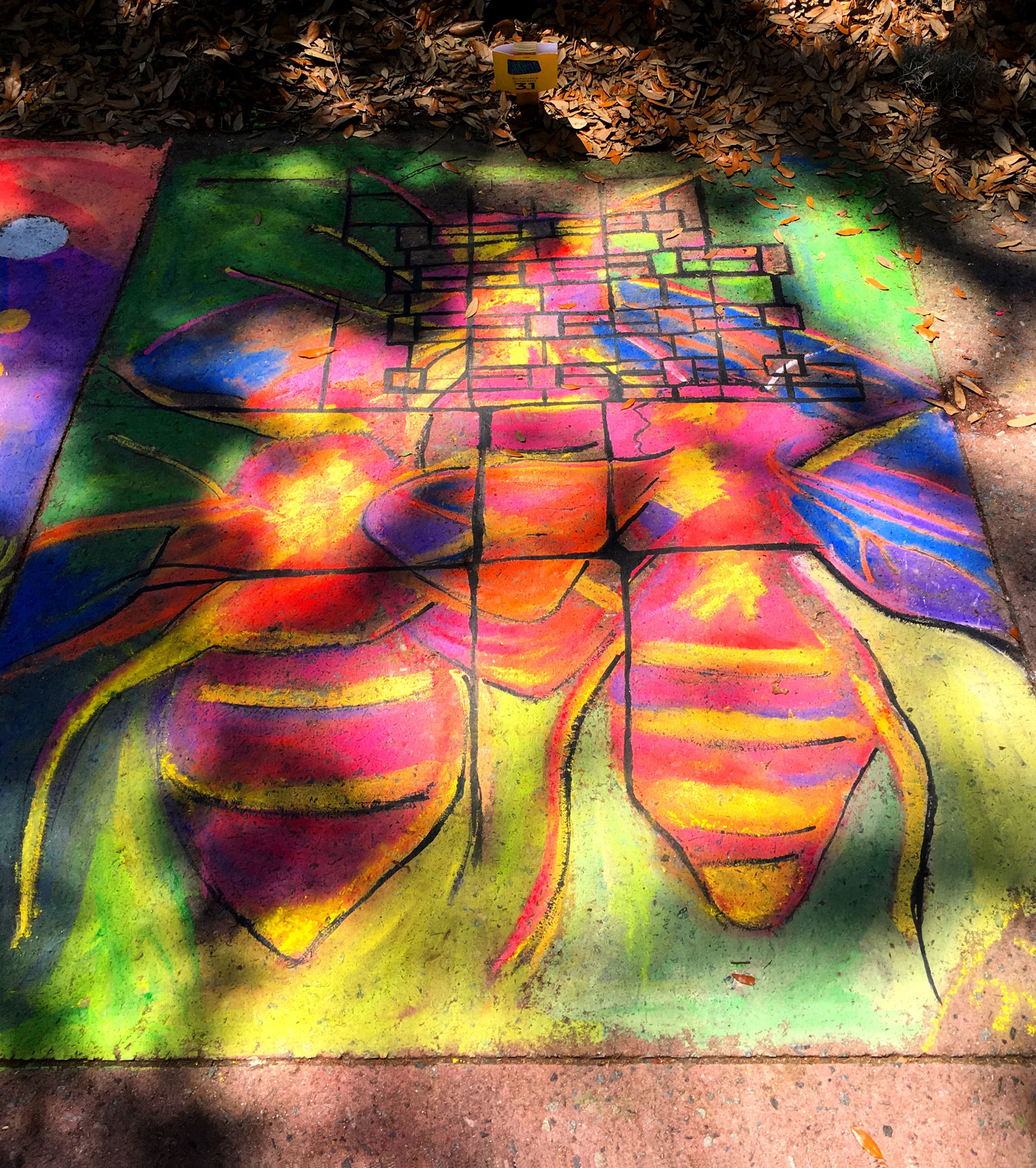 - Neon honey bees and a city map. It was a long day and my hands were stained, but it was so great to see Forsyth Park come to life with so many decorated sidewalk squares! Until next year.
