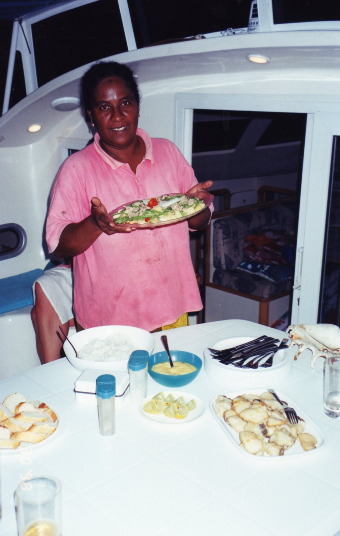 Tsakina serving dinner