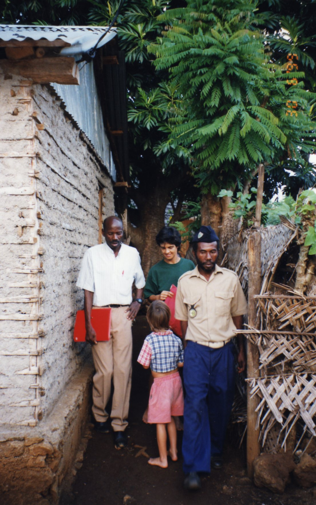 Being escorted by the officials to see their village