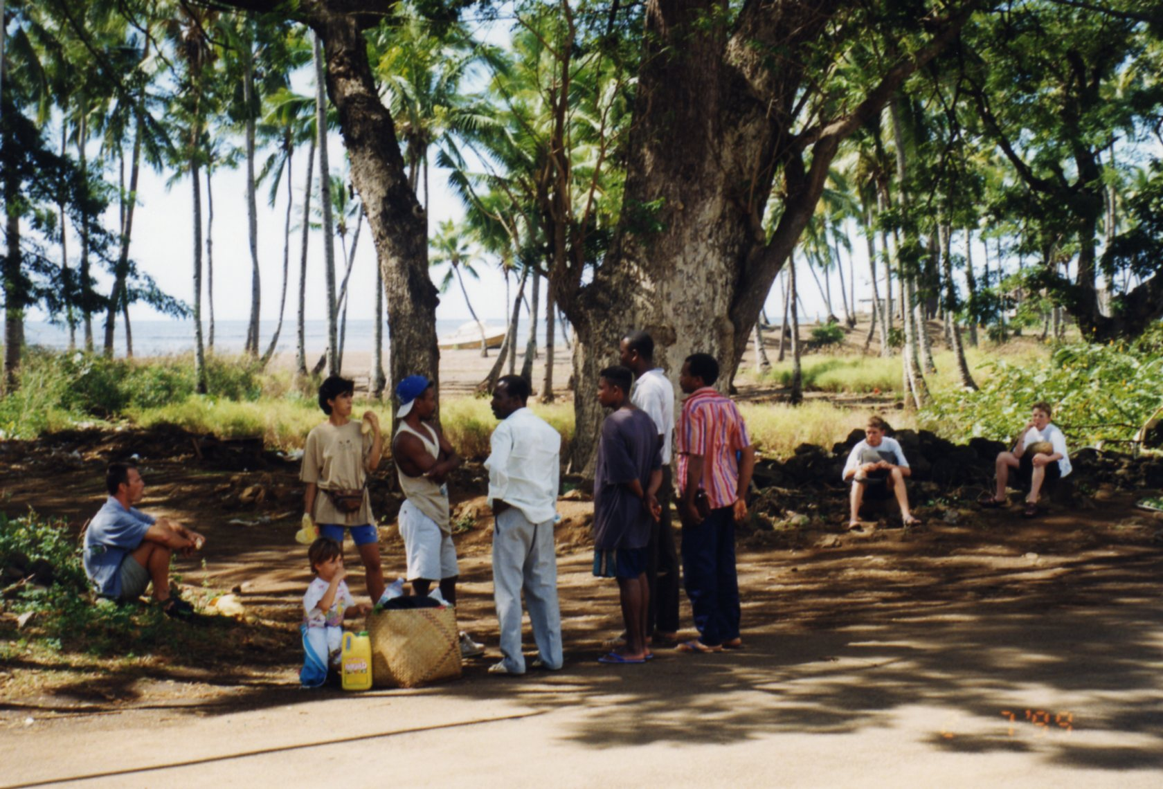 Waiting for taxi at Fomboni, eating rations of French bread and cheese