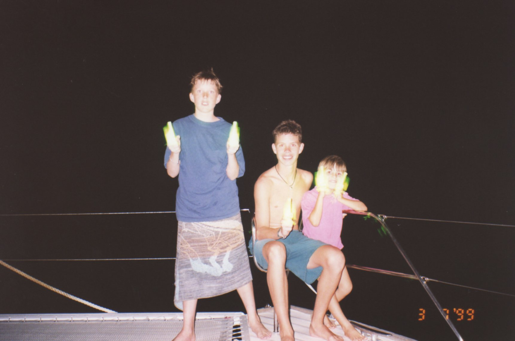 After night dive playing with glow sticks