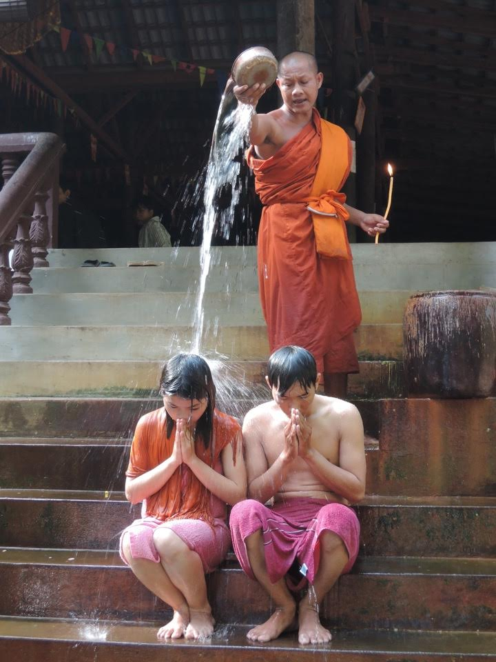 Buddhist ritual on the steps of a temple.