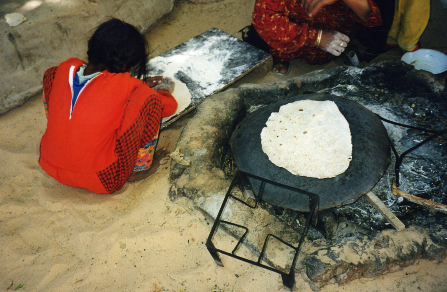 Making pita bread over the coals