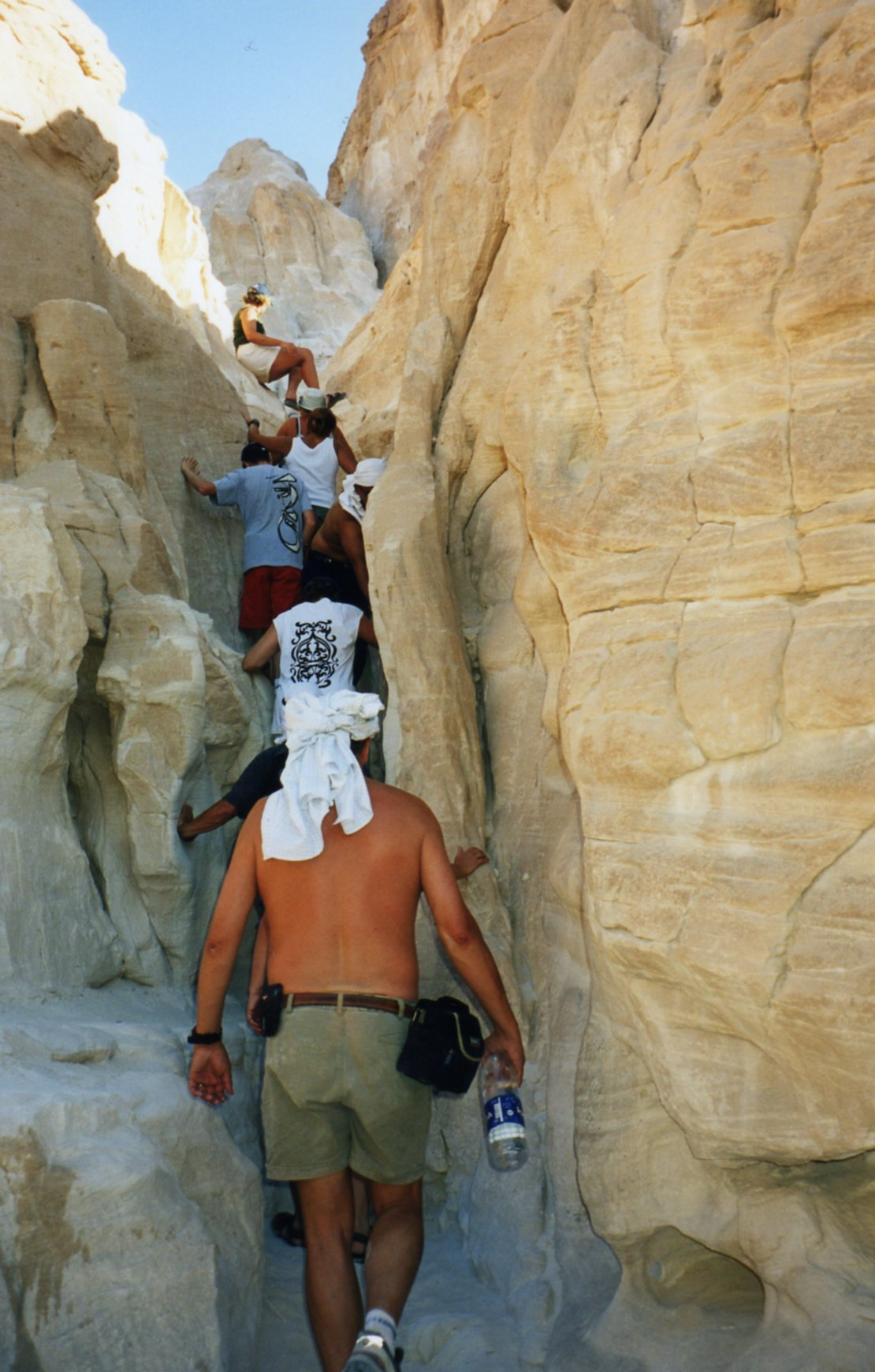 Climbing up a crevice at the White Canyon