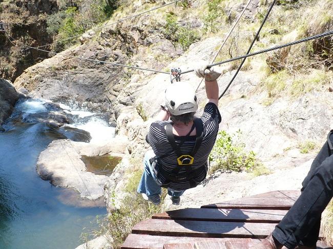 Sliding off sloping platform Magoebaskloof zipline.JPG
