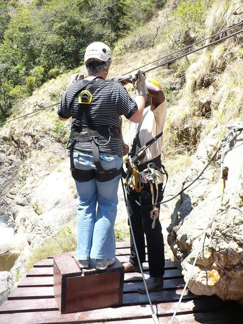 Stepping on box to reach zipline Magoebaskloof.JPG