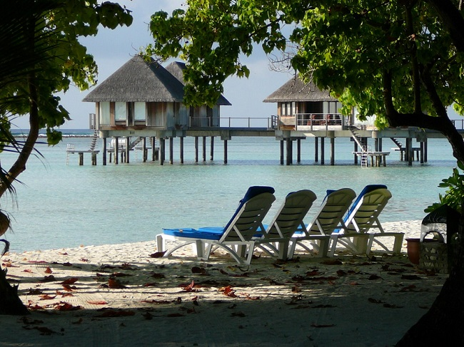Water bungalows, lounging chairs & private beach Club Med Kani.JPG