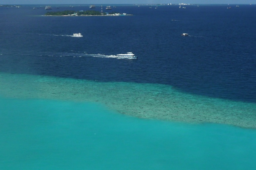 Lagoon, sea and boats from sky Maldives.JPG