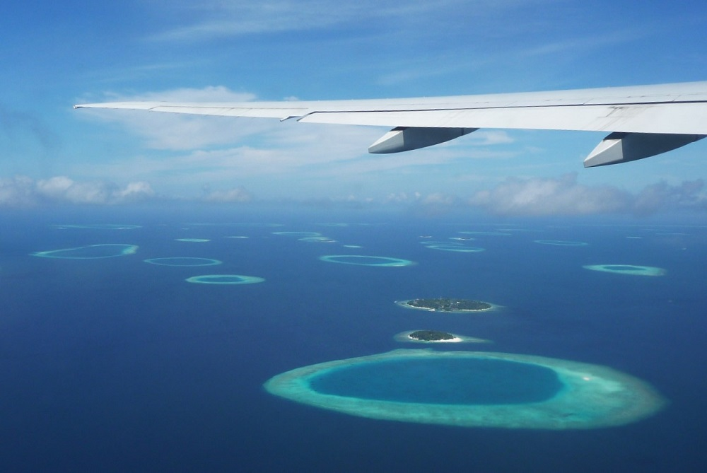 Maldives islands and lagoons from sky.JPG