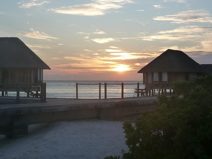 Sunset between water bungalows Club Med Kani.JPG