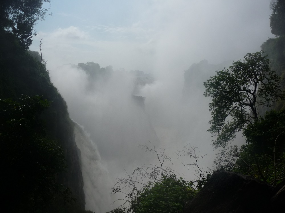 Mist from Victoria Falls hiding the falls.JPG
