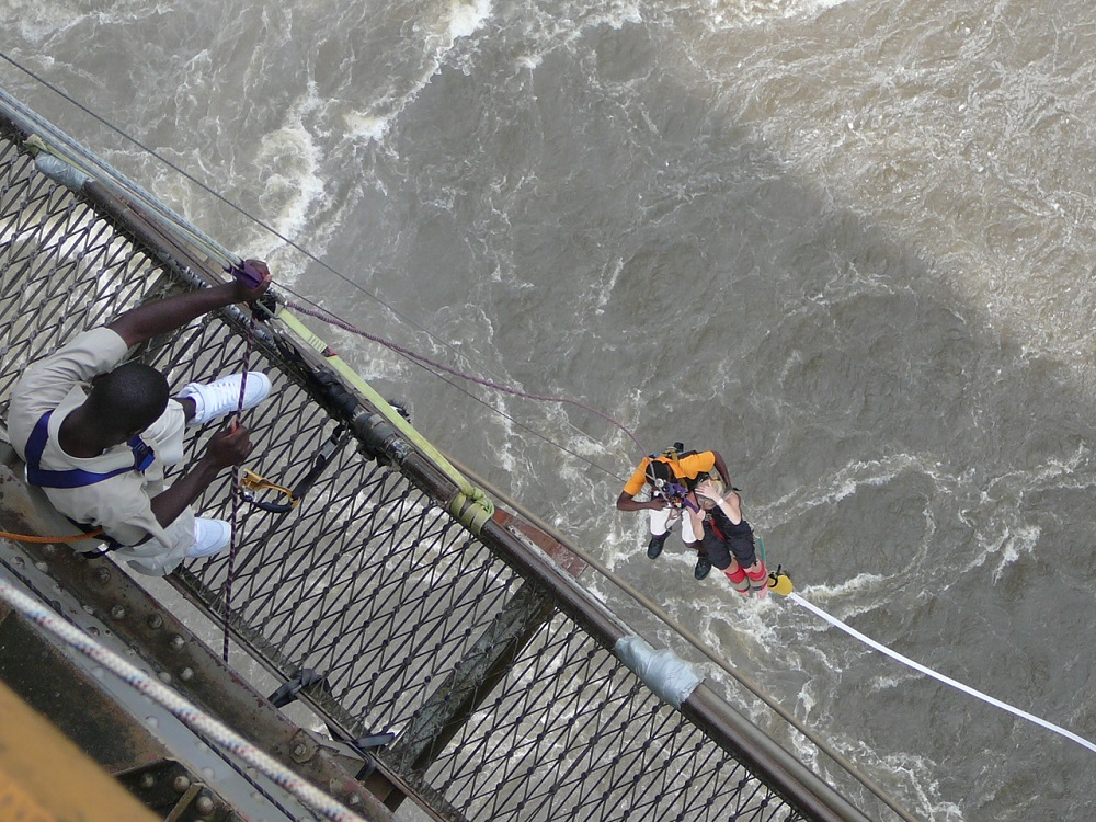 Bungee jumper dangling off Victoria Falls bridge.JPG