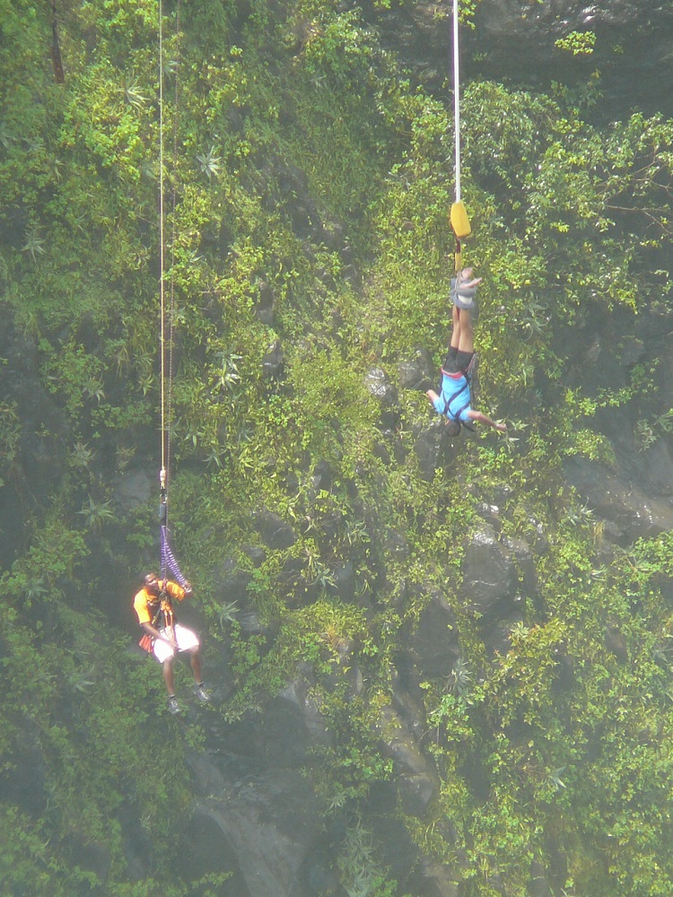 Bungee jumpers swinging off bridge Victoria Falls.JPG