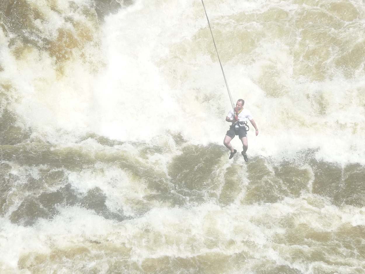 Bungee jumper hanging over river at Victoria Falls.JPG
