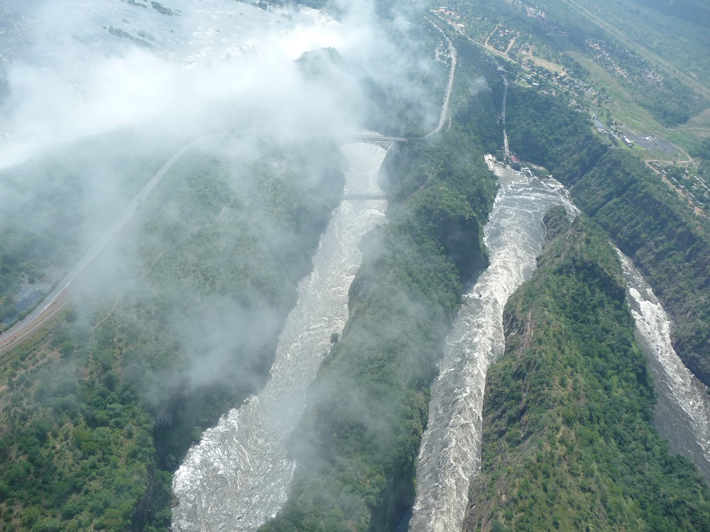 Mist and Victoria falls with gorge from air.JPG