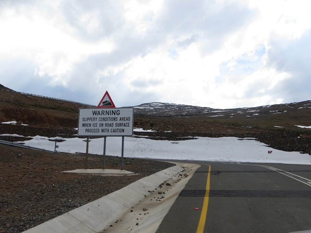 Good road in Lesotho but the area barren, rugged and windswept (and freezing!)