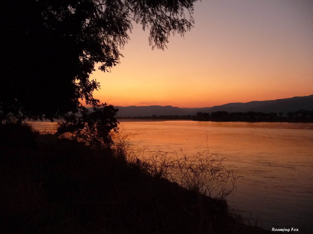Watching the sun set over the Zambezi river at Mana Pools in Zimbabwe, with Zambia on the other side