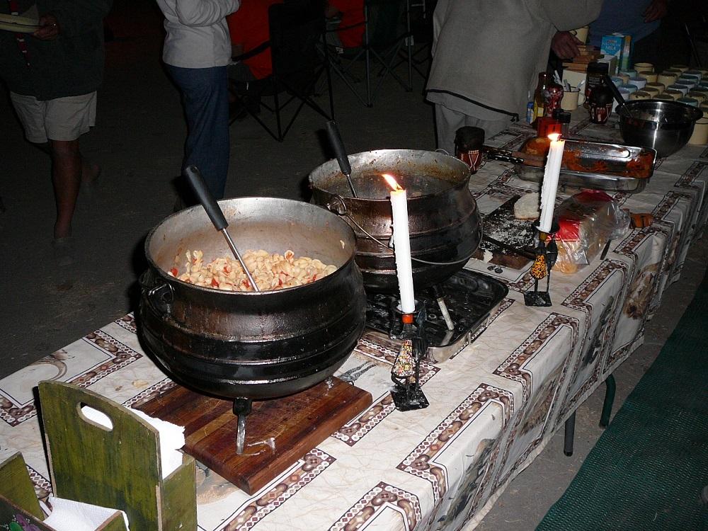 Food served 3 legged pots.JPG