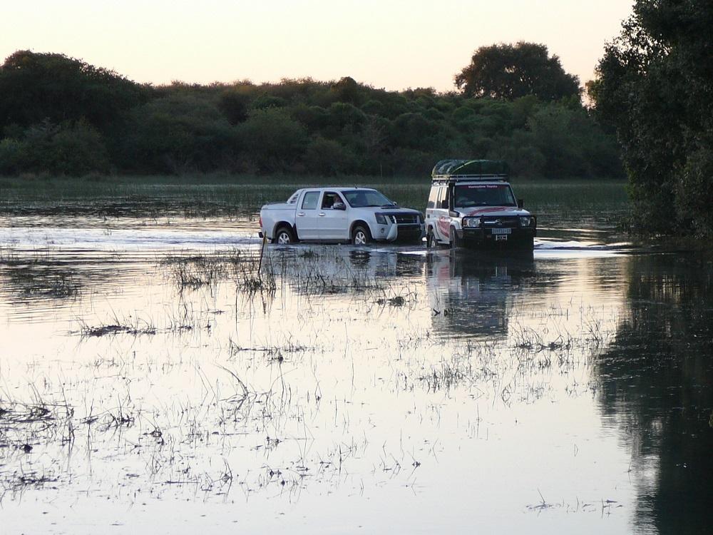 Vehicle being towed through water Okavango.JPG