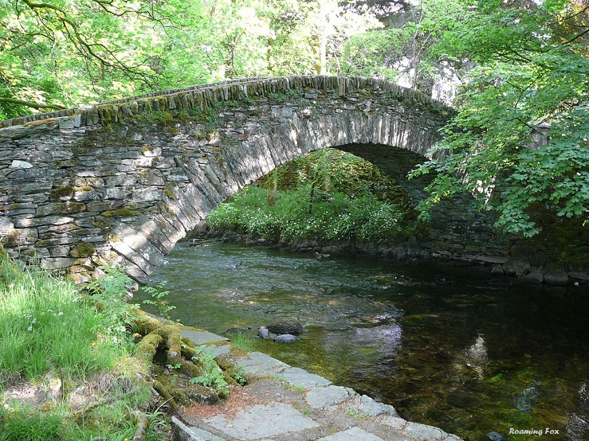 Beautiful stone bridge covered with moss