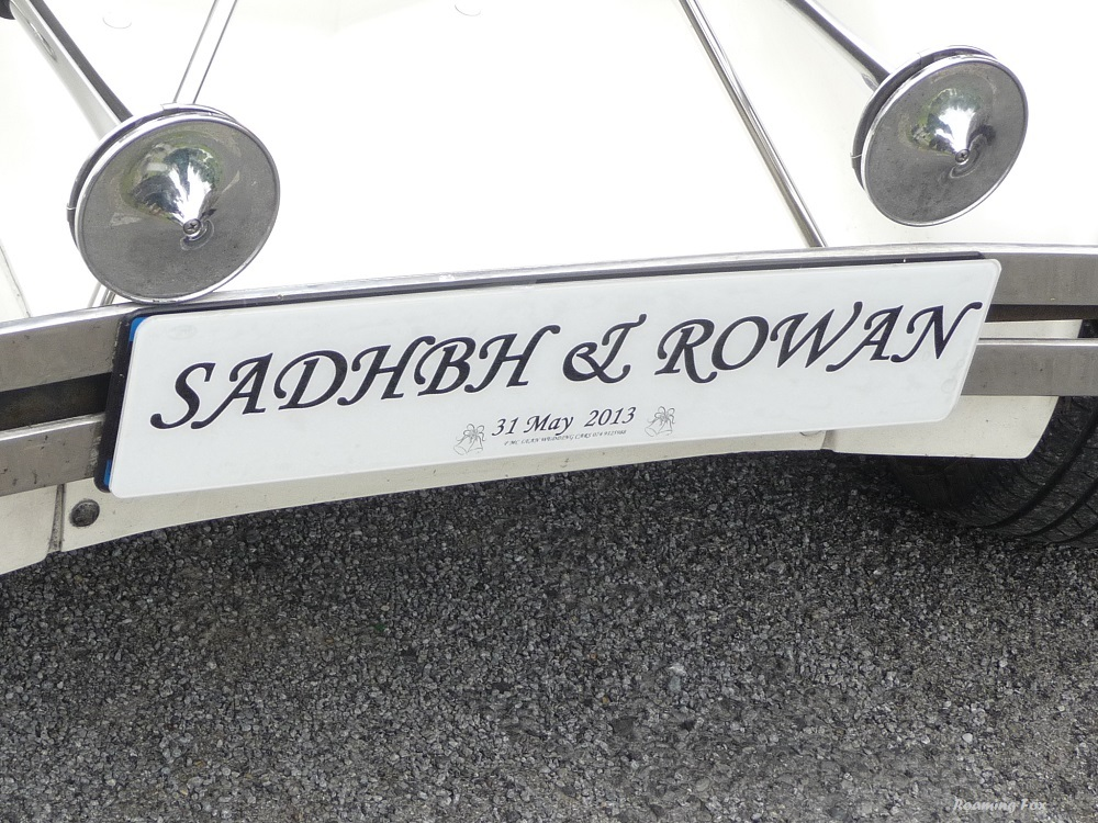 Number plate with wedding couples names on wedding car