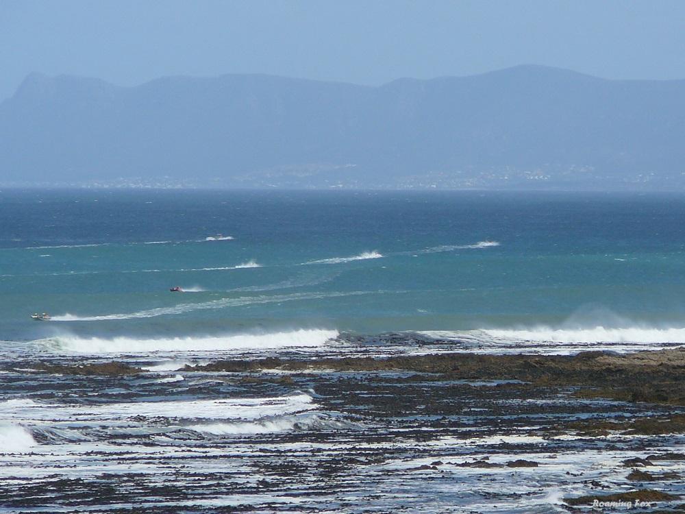 Inflatable dinghies racing over Walker Bay between Gansbaai and Hermanus
