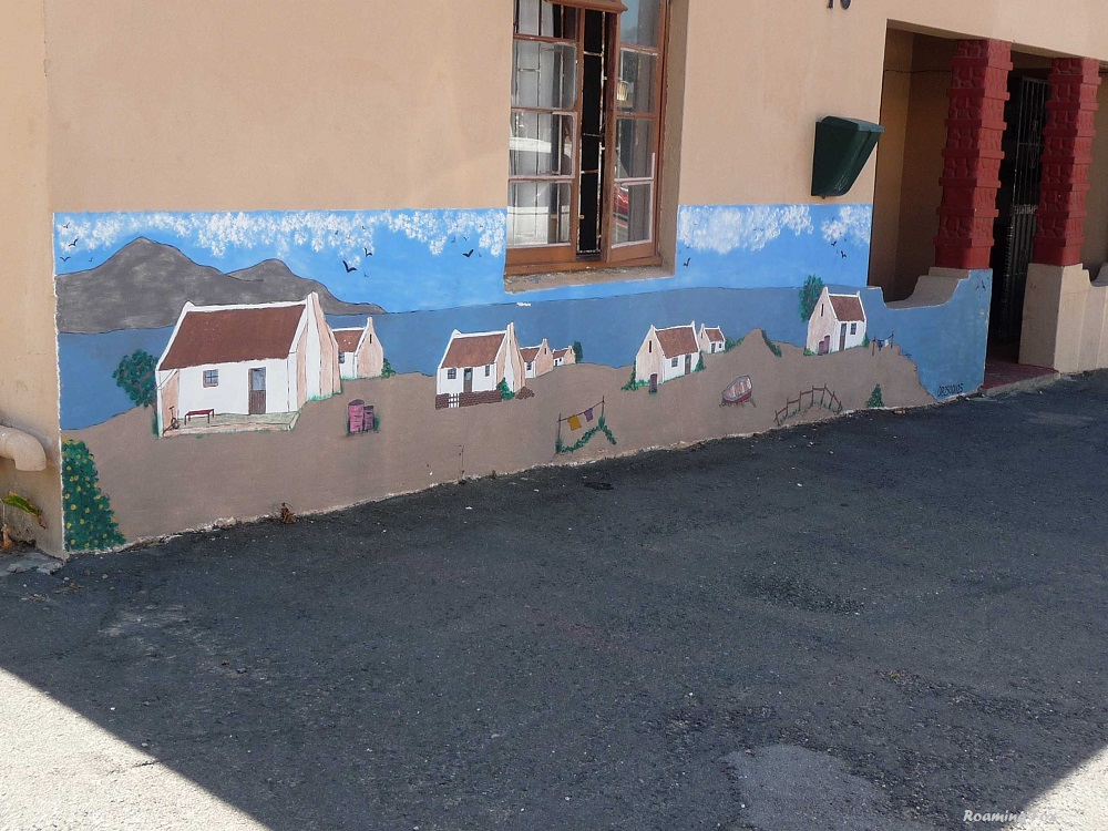 Street art depicting typical fishing houses from the past