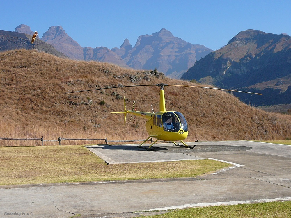 Is it a toy or is it real? Maybe it was dwarfed by the magnificent mountains in the background