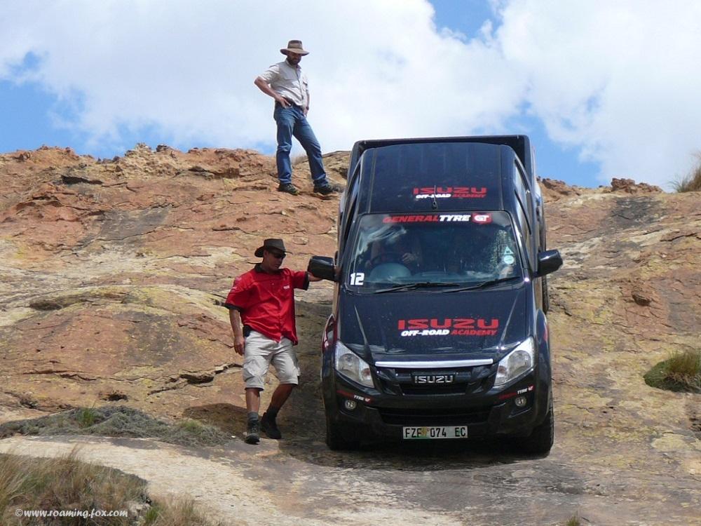 Marius guiding a driver down a steep slope