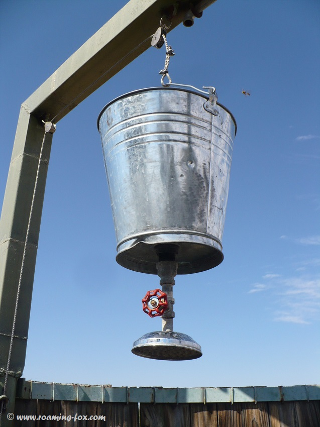 Bucket shower on a pulley system