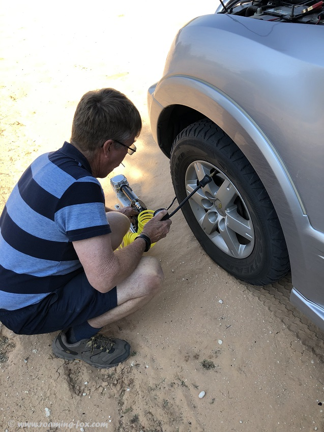 Inflating tyres with a portable air compressor