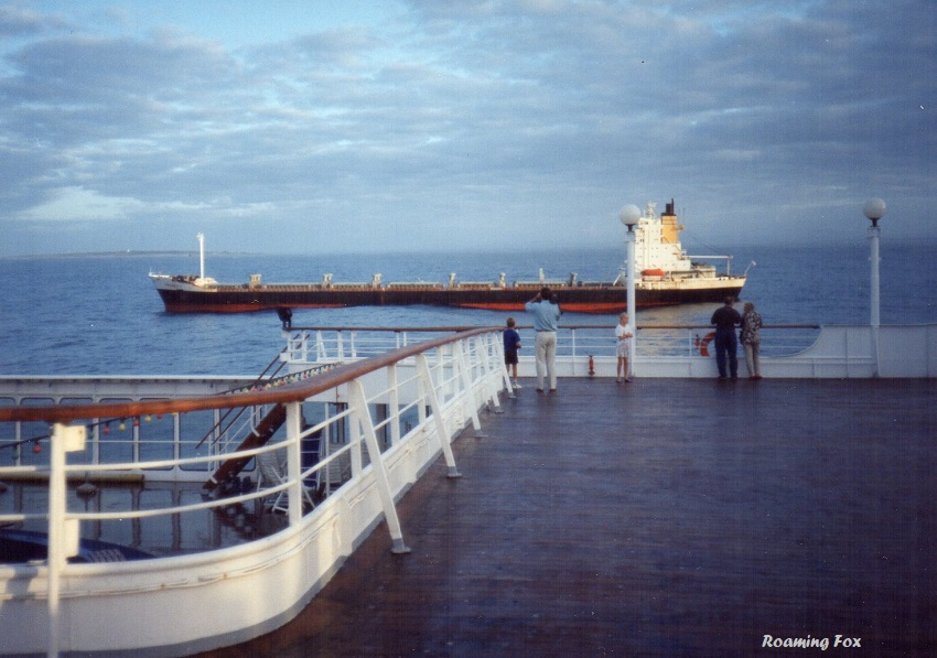 Robben island in the background, a tanker and the deck of the Achille Lauro